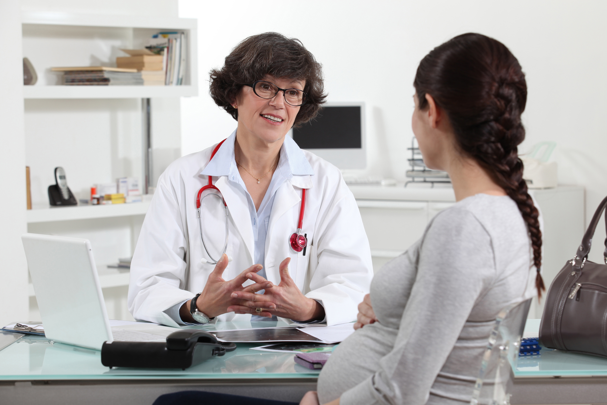 Pregnant woman in doctors appointment